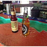 Photo taken at Undertow Beach Bar by Catherine R. on 3/1/2013