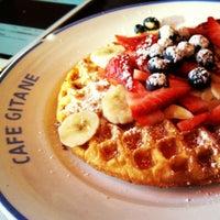 Photo taken at Café Gitane by C W. on 12/24/2012
