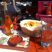 Photo taken at Mango's Taqueria and Cantina by Liza G. on 9/18/2012