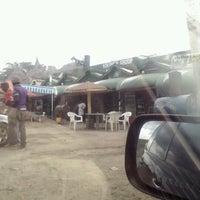 Photo taken at Kikopey Nyama Choma by Kattie L. on 12/20/2012