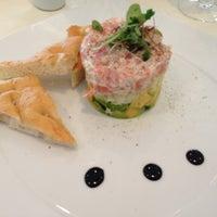 Photo taken at Olivos Restaurant by Tatiana C. on 4/9/2013