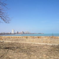 Photo taken at 63rd Street Beach by Tyler N. on 4/7/2013