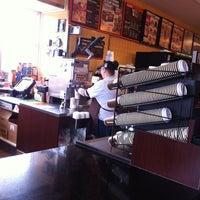 Photo taken at Dunkin' Donuts by Belynda B. on 3/20/2013