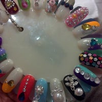 Photo taken at Fancy Nails 2 by Nikki W. on 10/18/2012