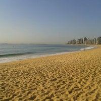 Photo taken at Praia da Costa by Vinícius T. on 11/23/2012