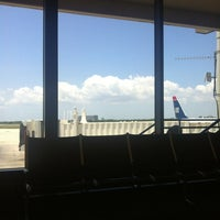 Photo taken at Gate F87 by Sebastian S. on 5/18/2013