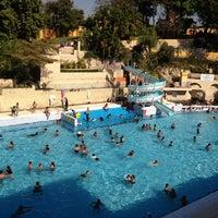 Photo taken at Balneario Agua Hedionda by Irwin D. on 3/9/2013