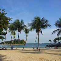 Photo taken at Palawan Beach by Daniel P. on 7/21/2013