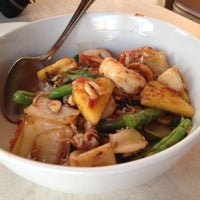 Photo taken at Mini Mango Thai bistro (New name: Mango on main) by Andrew H. on 10/17/2013