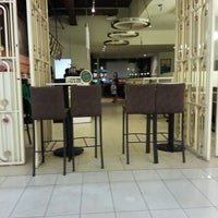 Photo taken at Austin Chase Coffee by Azida A. on 2/16/2013