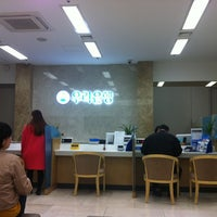 Photo taken at WOORI BANK by SangJin Y. on 4/4/2013