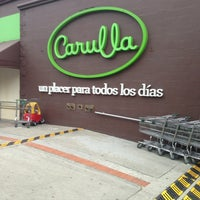 Photo taken at Carulla by Gustavo C. on 3/1/2013