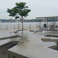 Photo taken at Two Too Large Tables - Hudson River Park by Joe F. on 5/27/2014