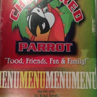 Photo taken at Checkered Parrot by Malcolm M. on 3/10/2013