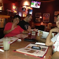 Photo taken at Boston's Restaurant & Sports Bar by Jennifer W. on 11/3/2012