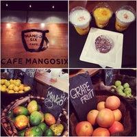 Photo taken at Cafe Mangosix by Yoshiko S. on 9/2/2014