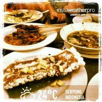 Photo taken at Kafe Betawi by Ananda R. on 3/23/2013