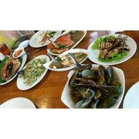 Photo taken at Telaga Seafood Restaurant by Regina C. on 12/30/2014
