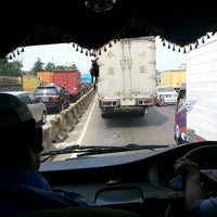 Photo taken at Gerbang Tol Pondok Gede Timur by Adjie S. on 4/5/2014