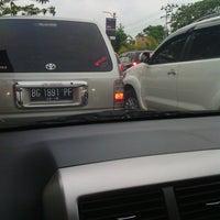 Photo taken at Lampu Merah Angkatan 66 by Rika A. on 1/31/2014