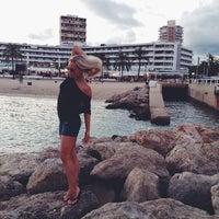 Photo taken at palma beach by Ksenia F. on 8/23/2014