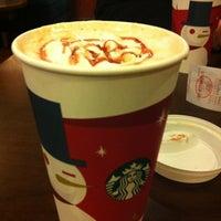 Photo taken at 星巴克 Starbucks by Anna K. on 12/14/2012