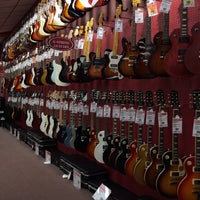 Photo taken at Guitar Center by Jenny T. on 12/7/2013