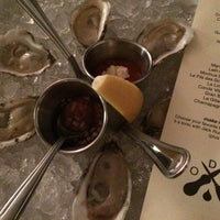 Photo taken at Dylan's Oyster Cellar by Scotti O. on 4/17/2014
