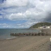 Photo taken at Aberystwyth Beach by Anthony W. on 8/8/2017