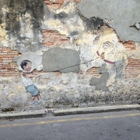 Photo taken at Penang Street Art : Little Boy with Pet Dinosaur by Danny C. on 1/17/2013