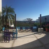 Photo taken at Santa Cruz Huatulco by Andrei O. on 11/24/2016