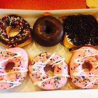 Photo taken at Dunkin' Donuts by Pâmella F. on 4/13/2015