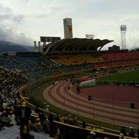 Photo taken at Estadio Olimpico Atahualpa by Jeff B. on 10/12/2012