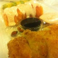 Photo taken at Sushi Blues Express by Emmanuel S. on 3/6/2013