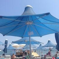 Photo taken at Parıltı Beach by Zeynep A. on 8/15/2013