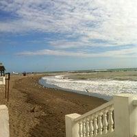 Photo taken at Playa Marina Beach by Dhuyvetter J. on 1/4/2013