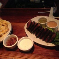 Photo taken at Outback Steakhouse by Virgilio C. R. on 2/9/2013