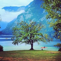 Photo taken at Bohinjsko jezero (Bohinj Lake) by Julia T. on 4/12/2013