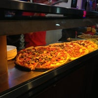 Photo taken at Roppolo's Pizzeria by Dani M. on 3/12/2013