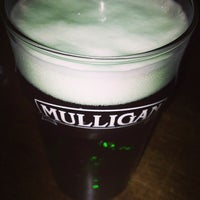 Photo taken at Mulligan Irish Pub by Diogo F. on 3/18/2013
