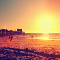 Photo taken at Newport Pier by Damien F. on 12/28/2012