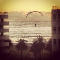 Photo taken at Sea Point Beach Promenade by Leezl K. on 7/24/2013
