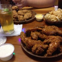 Photo taken at Hooters by Anna C. on 9/26/2012