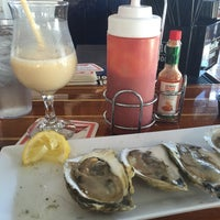 Photo taken at Shuckers Raw Bar by Christina K. on 8/4/2016