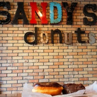 Photo taken at Sandy's Donuts by Christopher S. on 3/12/2018