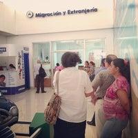 Photo taken at Dirección General de Migración y Extrangería (DGME) by Carlos Q. on 8/26/2013