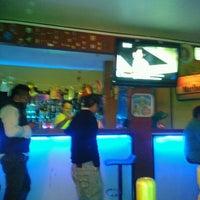 Photo taken at La Perla Bar by Hiram G. on 1/12/2013