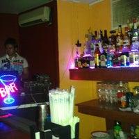 Photo taken at La Perla Bar by Hiram G. on 12/9/2012