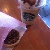 Photo taken at Starbucks by Juls I. on 10/22/2014