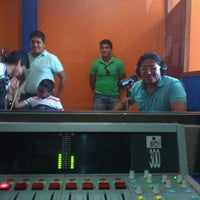 Photo taken at Radio Palenque by tito H. on 9/20/2012